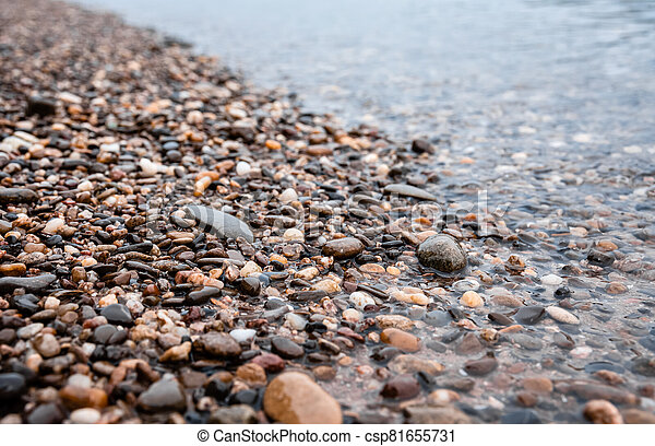 Water worn pebbles at the edge of a lake - csp81655731