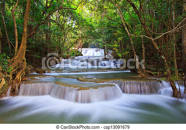 Waterfall and blue stream in the forest Kanjanaburi Thailand  - csp13091679