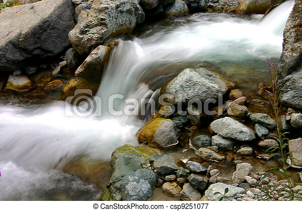 waterfall creeping on stone refreshes an environment - csp9251077