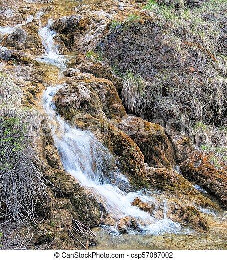 Waterfall hidden in the tropical jungle - csp57087002