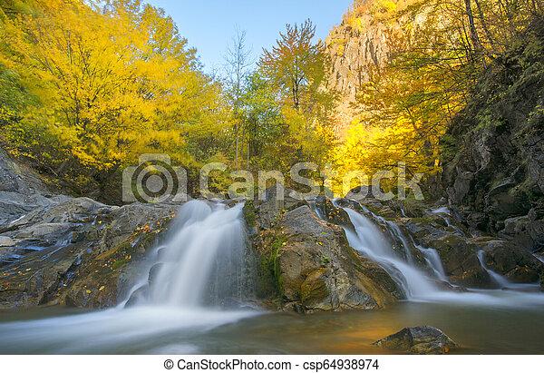 waterfall in autumn - csp64938974