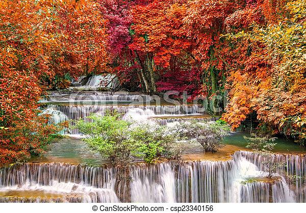 Waterfall in deep rain forest jungle (Huay Mae Kamin Waterfall i - csp23340156