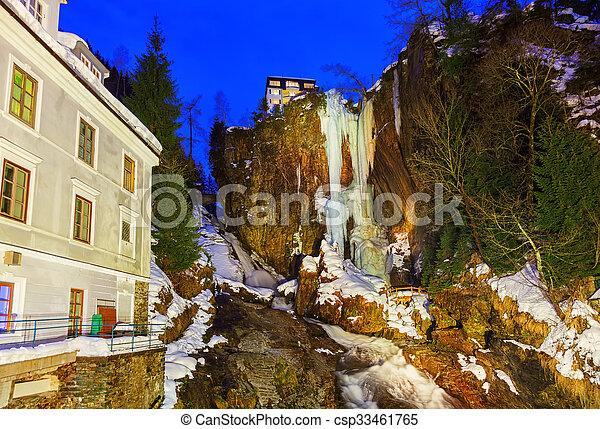 Waterfall in Mountains ski resort Bad Gastein Austria - csp33461765