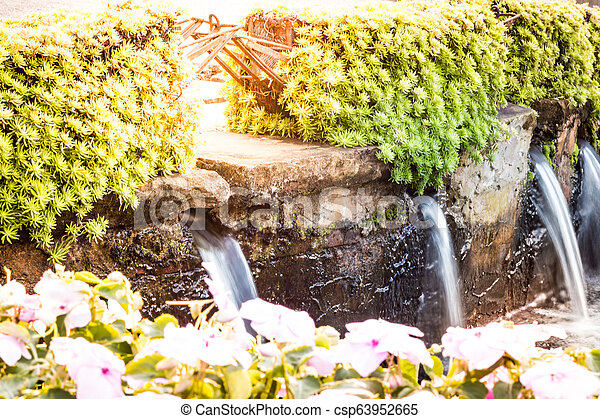 Waterfall in small size in the garden. - csp63952665