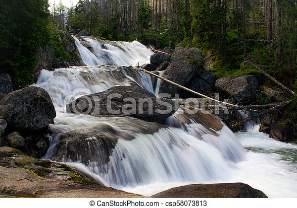Waterfall in the mountains of the High Tatras in Slovakia - csp58073813