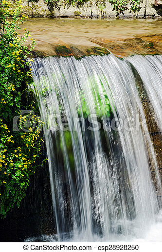Waterfall on the small river close-up - csp28928250