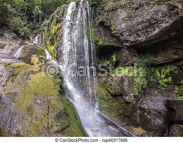waterfalls in the mountains on lake jocassee south carolina - csp40317666