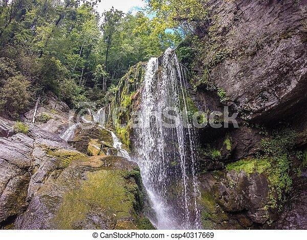 waterfalls in the mountains on lake jocassee south carolina - csp40317669