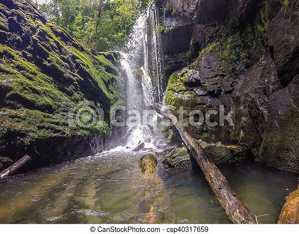waterfalls in the mountains on lake jocassee south carolina - csp40317659