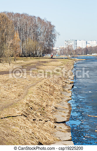 waterfront in urban park in early spring - csp19225200
