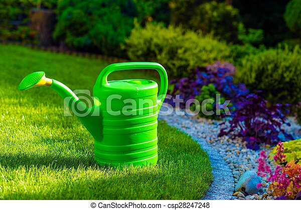 Watering Can in a Garden - csp28247248