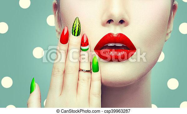Watermelon nail art and makeup closeup over polka dots background.