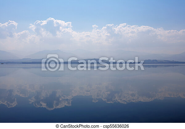 Waterscape of lake with cloudy sky reflection - csp55636026