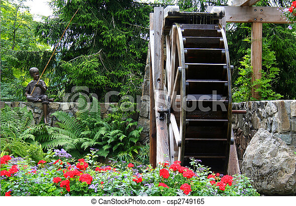 Waterwheel In A Flower Garden   Csp2749165