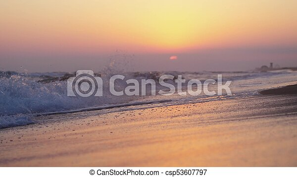 Waves at the beach in the evening at sunset - csp53607797