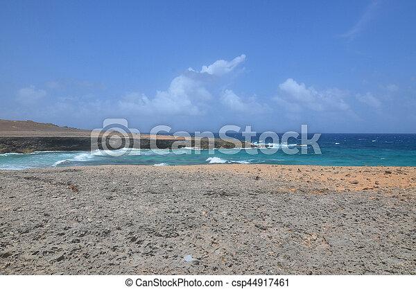 Waves Crashing Ashore on Daimari Beach in Aruba - csp44917461