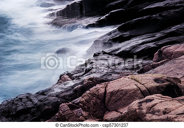 Waves crashing on rocks. - csp57301237