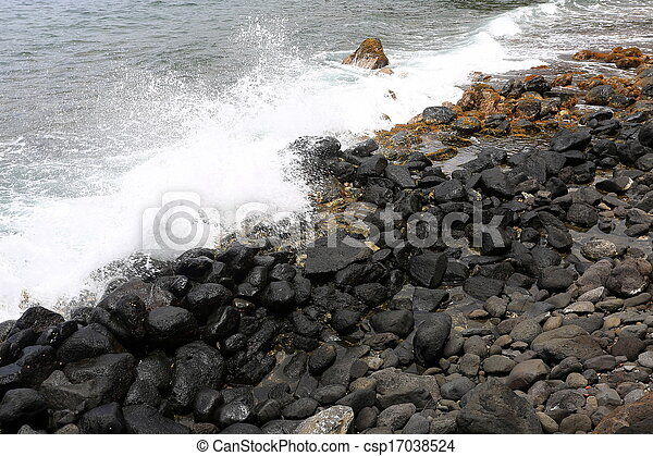 waves crashing on rocky beach - csp17038524