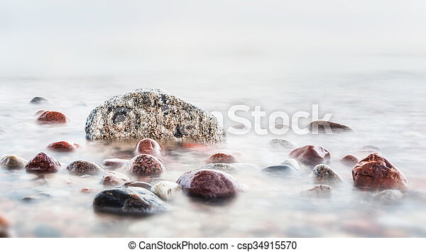 Waves hitting in rocks on the sea - csp34915570