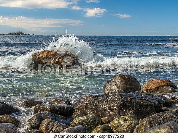 Waves hitting rock in Norway - csp48977220