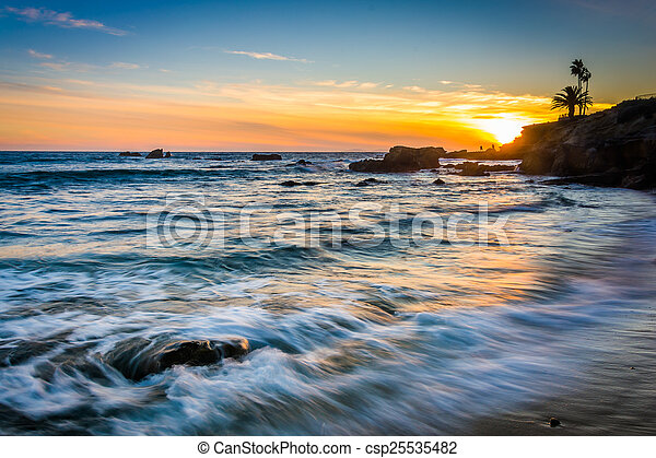 Waves in the Pacific Ocean at sunset, seen from Heisler Park, in - csp25535482