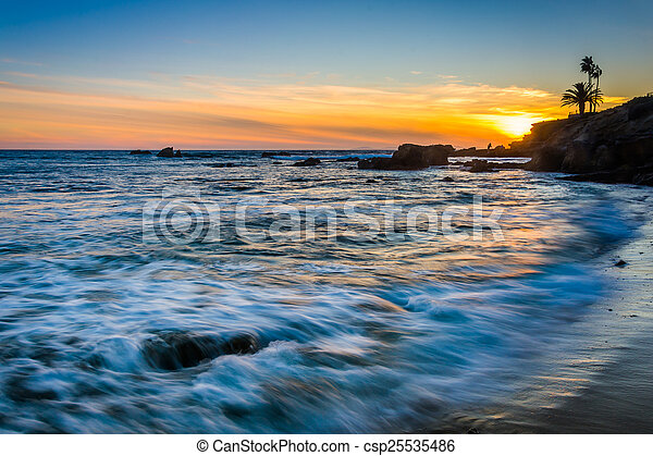 Waves in the Pacific Ocean at sunset, seen from Heisler Park, in - csp25535486