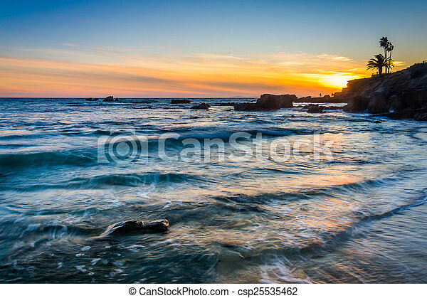 Waves in the Pacific Ocean at sunset, seen from Heisler Park, in - csp25535462