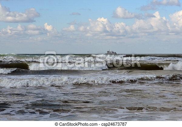 Waves of the Black Sea, Anapa, Krasnodar Krai. The ship in the s - csp24673787