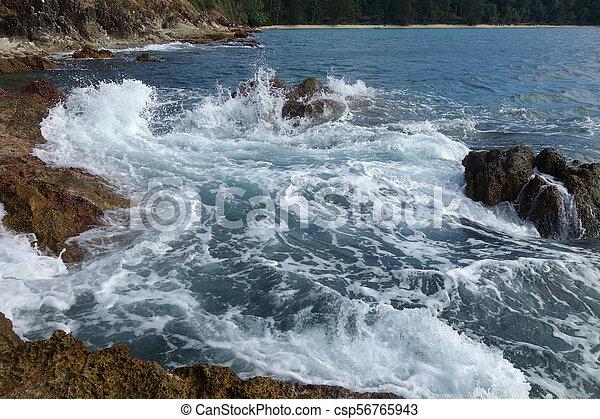 Waves on stone beach - csp56765943