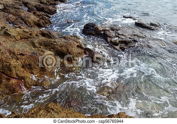 Waves on stone beach - csp56765944