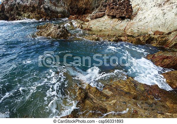 Waves on stone beach - csp56331893