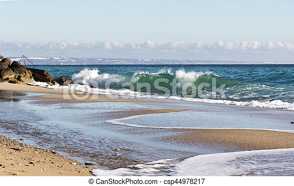 Waves on the beach of the Black Sea in Bulgaria - csp44978217