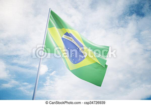 Waving Brazilian flag on a sky background - csp34726939
