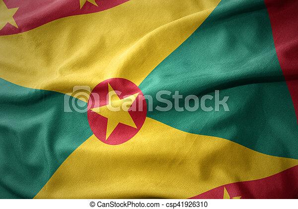 waving colorful flag of grenada. - csp41926310