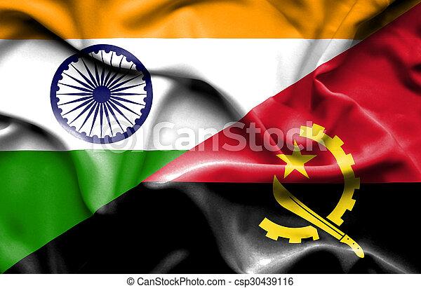 Waving flag of Angola and India - csp30439116