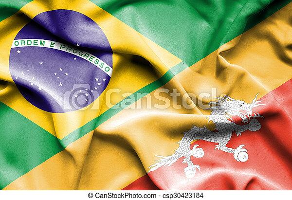 Waving flag of Bhutan and Brazil - csp30423184