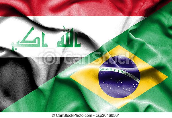 Waving flag of Brazil and Iraq - csp30468561