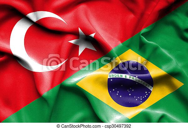 Waving flag of Brazil and Turkey - csp30497392
