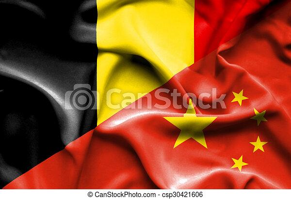 Waving flag of China and Belgium - csp30421606