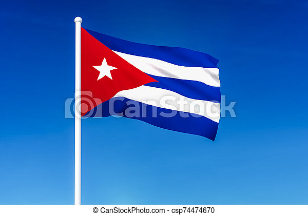 Waving flag of Cuba on the blue sky background - csp74474670