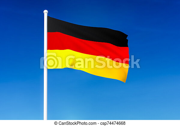 Waving flag of Germany on the blue sky background - csp74474668