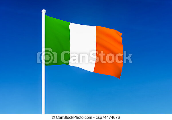 Waving flag of Ireland on the blue sky background - csp74474676