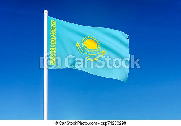 Waving flag of Kazakhstan on the blue sky background - csp74280298