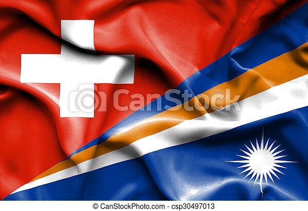 Waving flag of Marshall Islands and Switzerland - csp30497013