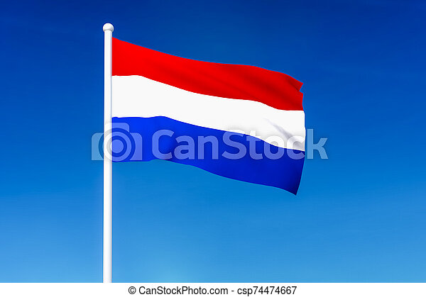 Waving flag of Netherlands on the blue sky background - csp74474667