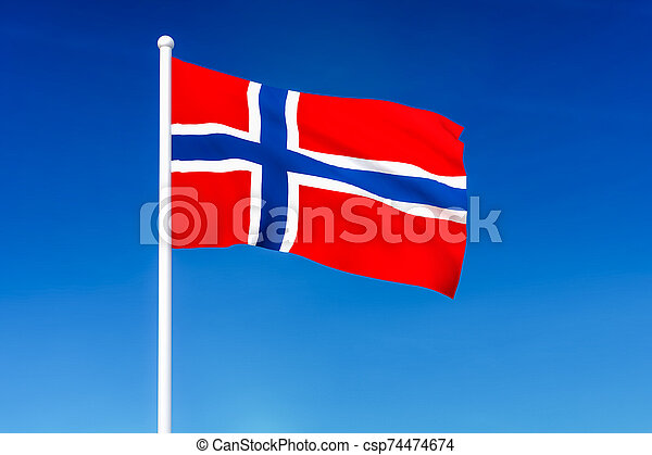 Waving flag of Norway on the blue sky background - csp74474674