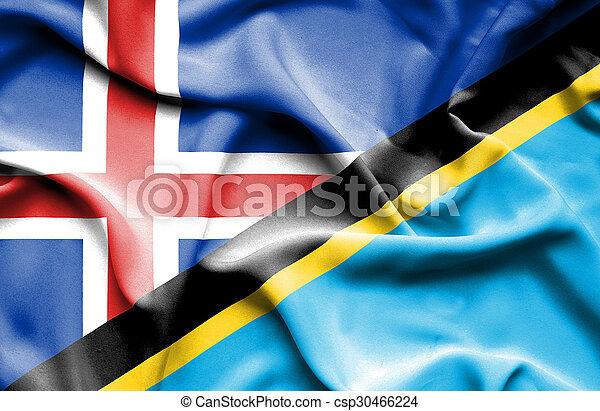 Waving flag of Tanzania and Iceland - csp30466224