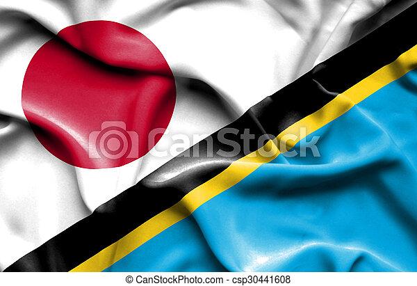 Waving flag of Tanzania and Japan - csp30441608