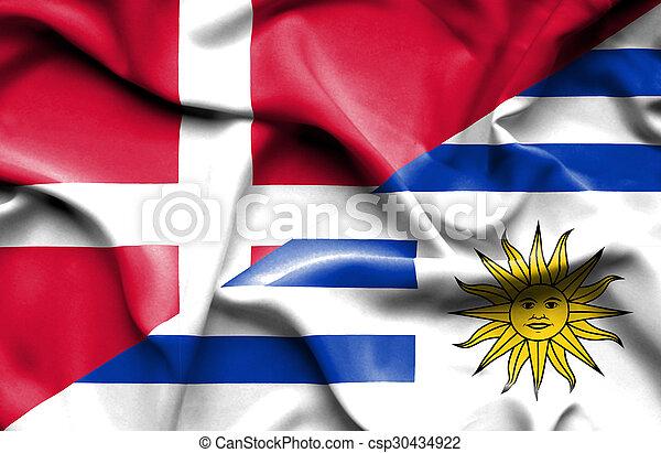 Waving flag of Uruguay and Denmark - csp30434922