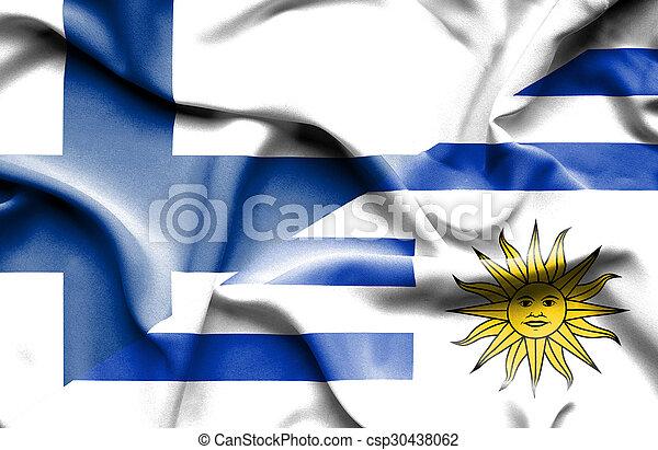 Waving flag of Uruguay and Finland - csp30438062